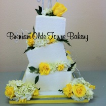 wonky crystal cake with yellow flowers