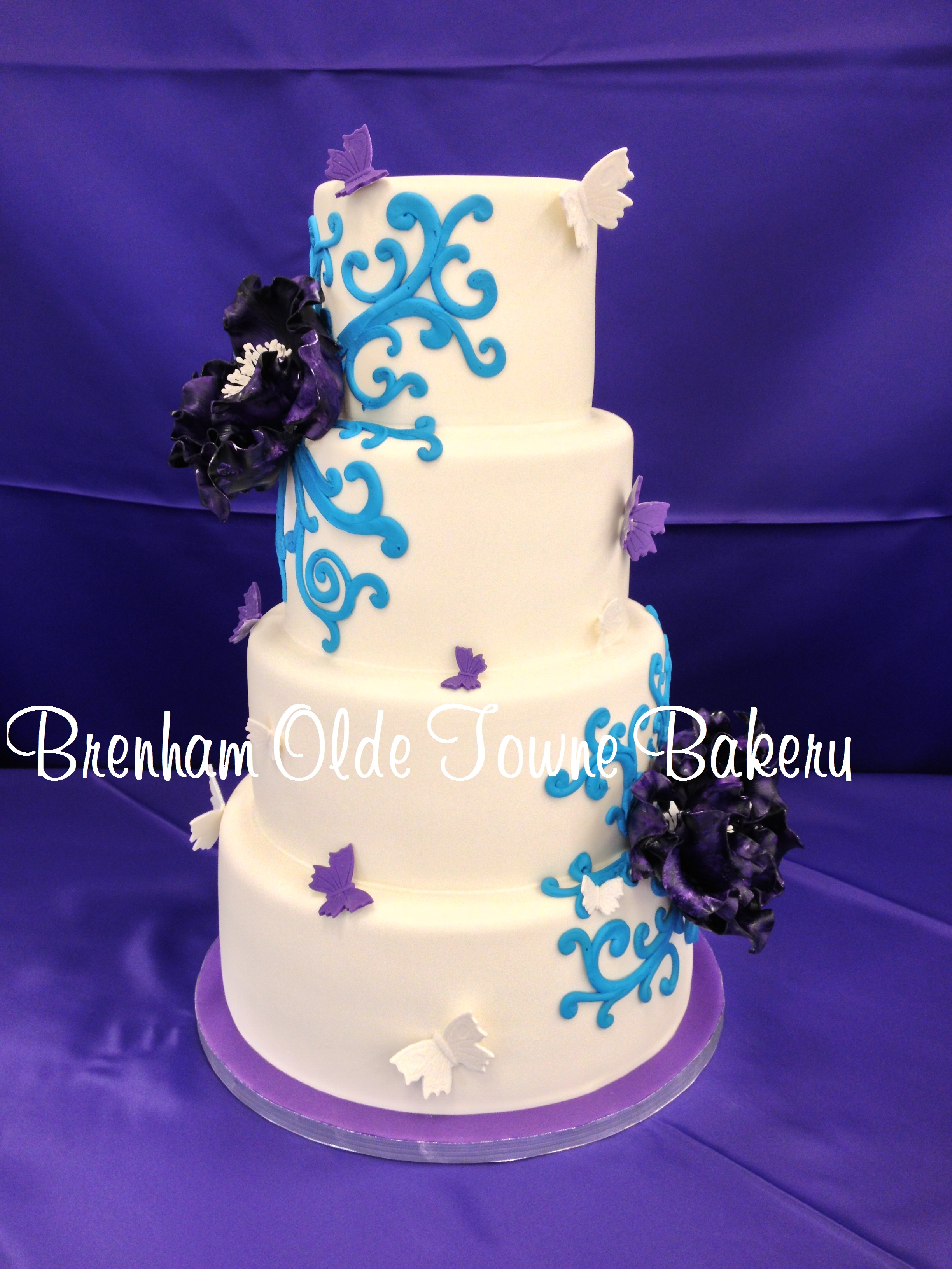 purple and blue butterflies wedding cake