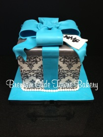 silver and blue present cake