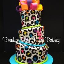 topsy turvy neon leopard print birthday cake