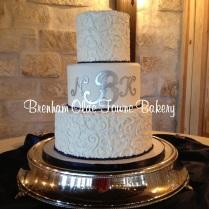 navy and white filigree wedding cake