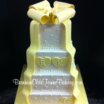 yellow bow and ribbon cake